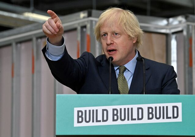 Britain's Prime Minister Boris Johnson gestures as he delivers a speech during his visit to Dudley College of Technology in Dudley, Britain, June 30, 2020.
