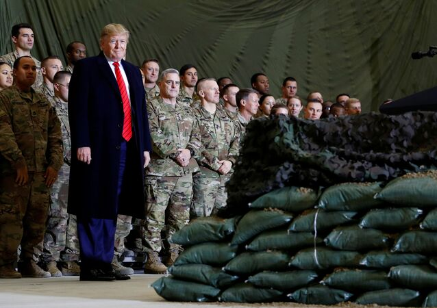 U.S. President Donald Trump delivers remarks to U.S. troops in an unannounced visit to Bagram Air Base, Afghanistan, November 28, 2019.