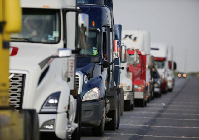 Trucks wait in a long queue for border customs control to cross into the U.S., at the World Trade Bridge in Nuevo Laredo, Mexico June 30, 2020.