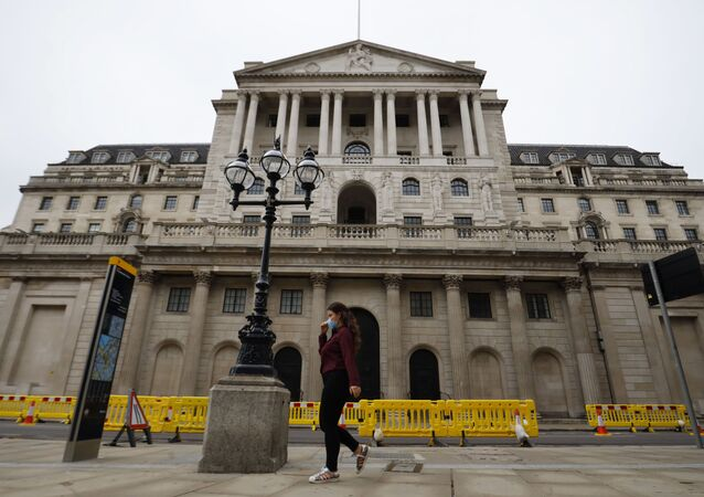 A pedestrian walks past the Bank of England in London on 17 June 2020.