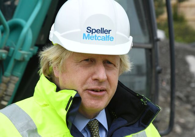 Britain's Prime Minister Boris Johnson visits the Speller Metcalfe's building site for The Dudley Institute of Technology in Dudley, Britain, June 30, 2020.