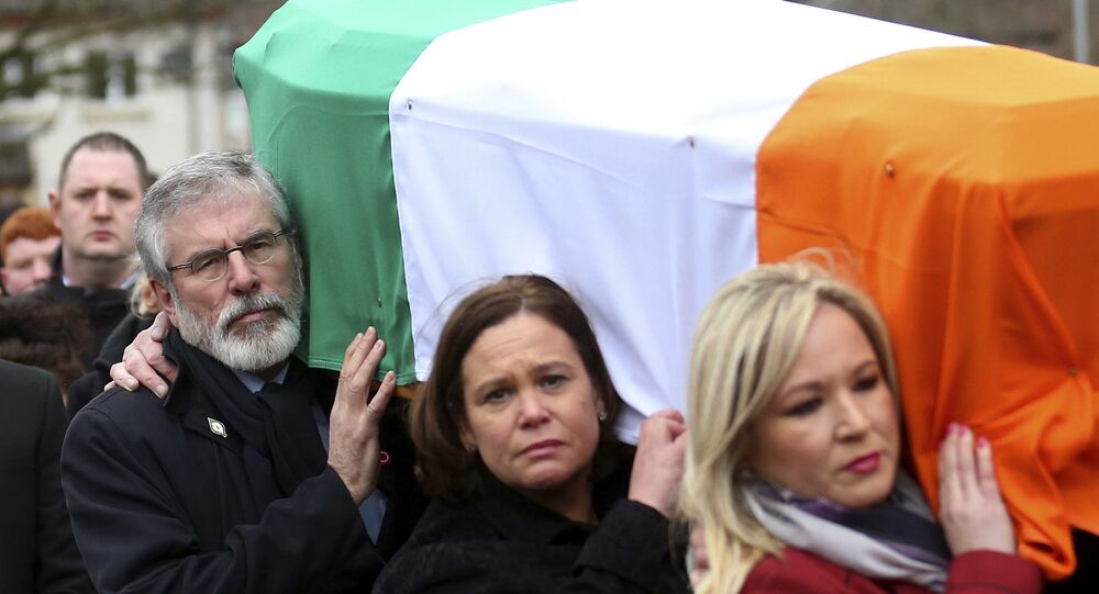 Michelle O'Neill (pictured, far right) carrying the coffin of former IRA commander and Sinn Fein deputy leader Martin McGuinness in 2017.