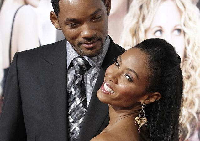 Actor Will Smith, left, and his wife, actress Jada Pinkett- Smith pose on the press line at the premiere of her latest film The Women in Los Angeles on Thursday, Sept. 4, 2008