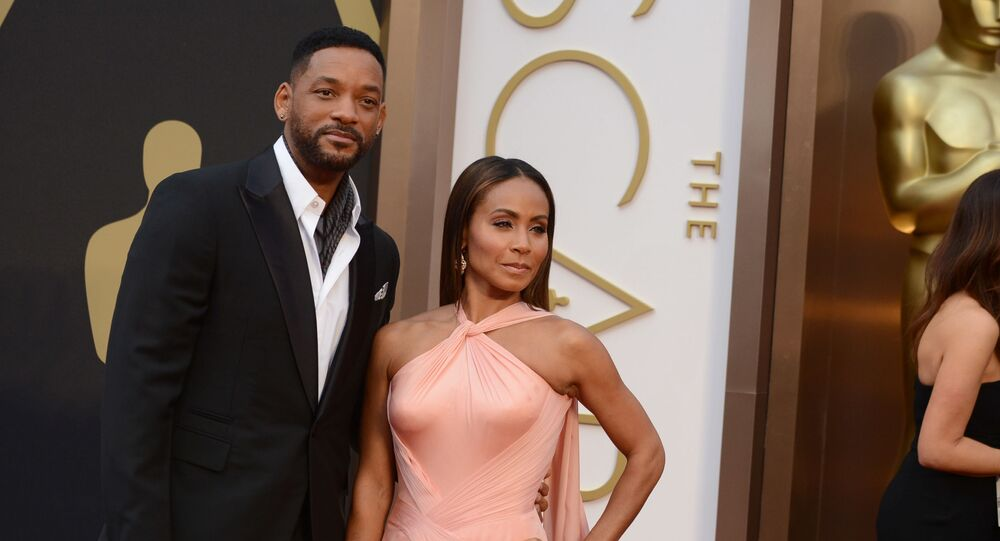 Will Smith, left, and Jada Pinkett Smith arrive at the Oscars on Sunday, March 2, 2014, at the Dolby Theatre in Los Angeles