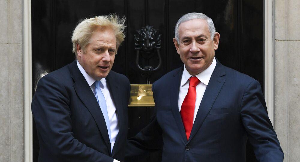 Britain's Prime Minister Boris Johnson greets Israeli Prime Minister Benjamin Netanyahu on the doorstep of 10 Downing Street, in London, Thursday, Sept. 5, 2019.
