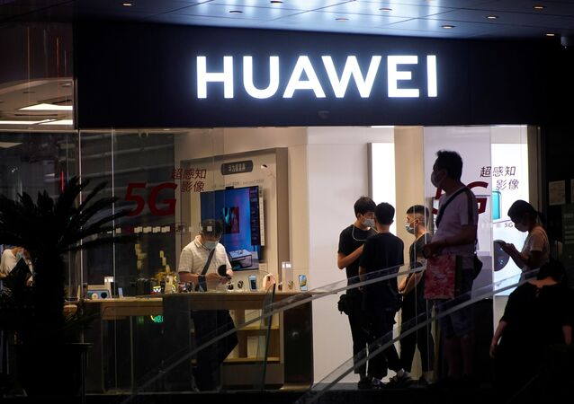 People are seen in a Huawei shop in Shanghai