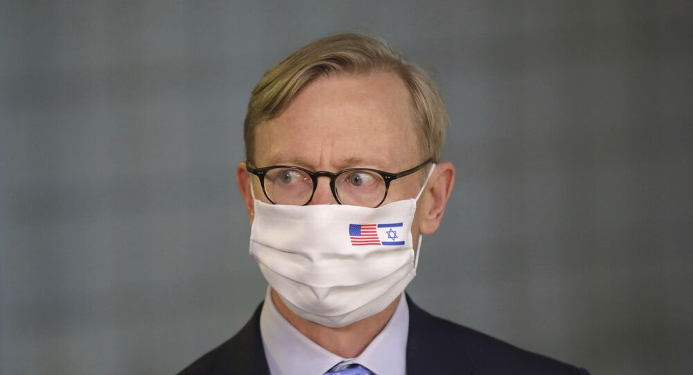 US special envoy for Iran, Brian Hook, attends a press briefing with Israeli Prime Minister Benjamin Netanyahu while wearing a face mask to help prevent the spread of the coronavirus, at the Prime Minister's office in Jerusalem, Tuesday June 30, 2020.