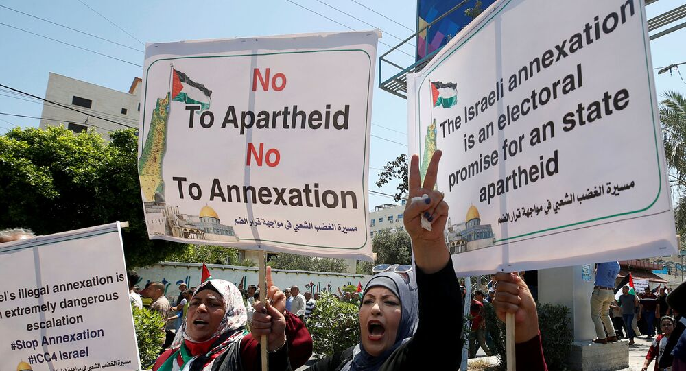 Demonstrators take part in a rally as Palestinians call for a 'day of rage' to protest against Israel's plan to annex parts of the Israeli-occupied West Bank, in Gaza City July 1, 2020.