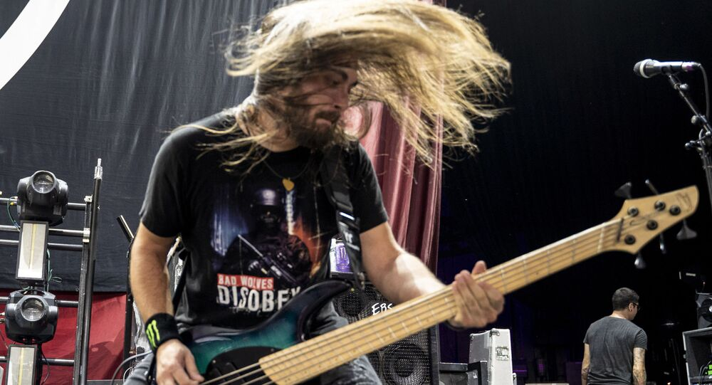 The American heavy metal band Bad Wolves with bass player Kyle Konkiel performs at the Xfinity Center, Saturday, Aug. 18, 2018, in Mansfield, Mass.