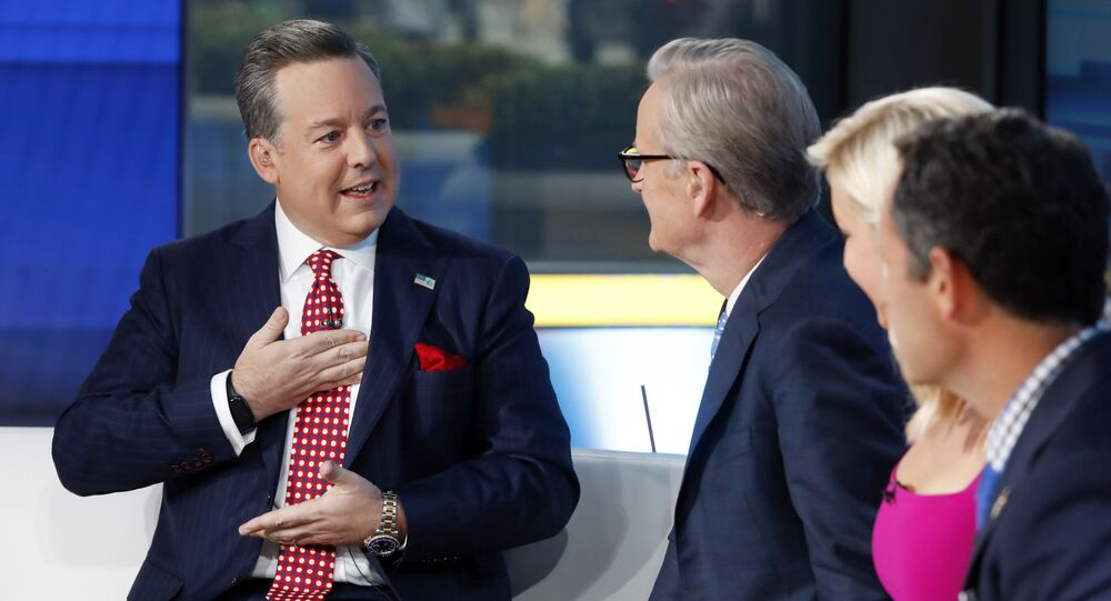 Fox News Chief National Correspondent Ed Henry, left, appears with co-hosts Steve Doocy, second left, Ainsley Earhardt, and Brian Kilmeade on the Fox & friends television program, in New York on Sept. 6, 2019. Fox News has fired news anchor Henry after it received a complaint about workplace sexual misconduct by him