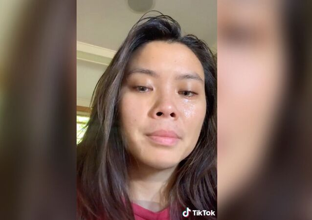 "A screenshot of Harvard University graduate Claira Janover, appears in a TikTok video with eyes full of tears after losing her job at Deloitte Touche Tohmatsu Limited over a viral video of her threatening to ""stab"" anyone who says all lives matter, 01.07.2020."