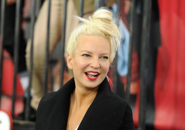 In this Dec. 7, 2014 file photo, singer Sia Furler attends the world premiere of Annie at the Ziegfeld Theatre in New York.