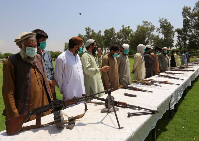 Members of the Taliban handover their weapons and join in the Afghan government's reconciliation and reintegration program in Jalalabad, Afghanistan June 25, 2020.