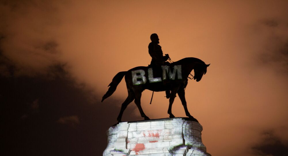 Artist Dustin Klein projects a Black Lives Matter image onto the statue of Confederate General Robert E. Lee in Richmond, Virginia, U.S. June 18, 2020