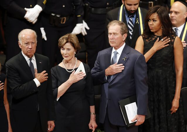 From left, Vice President Joe Biden, Laura Bush, former President George W. Bush, and first lady Michelle Obama stand during an interfaith memorial service for the fallen police officers and members of the Dallas community at the Morton H. Meyerson Symphony Center in Dallas, Tuesday, July 12, 2016, in Dallas.