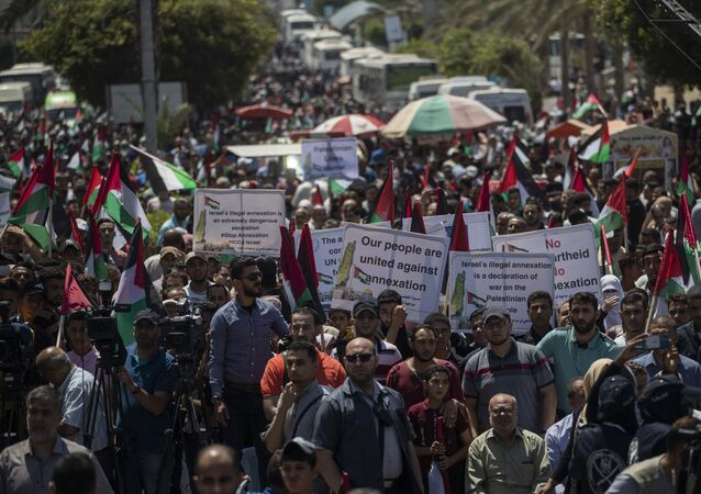 Palestinians demonstrate against Israeli plans for the annexation of parts of the West Bank, in Gaza City, Wednesday, July 1, 2020.
