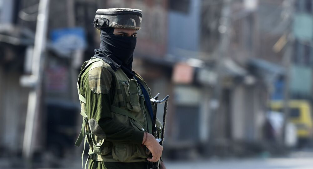 An Indian paramilitary soldier secures an area near the site of a gun battle between suspected militants and government forces in downtown Srinagar on May 19, 2020.