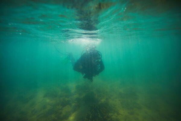 Scientists sent divers to explore possible locations of underwater Aboriginal sites. - Sputnik International