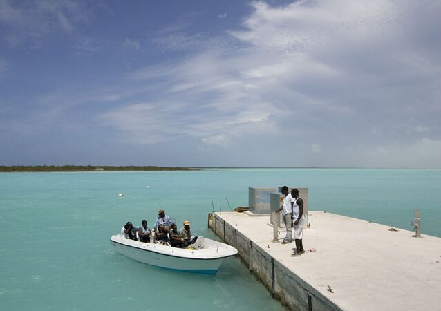 A speedboat shuttles residents back and forth from the islands of North Caicos and Providenciales in the Turks and Caicos Islands.