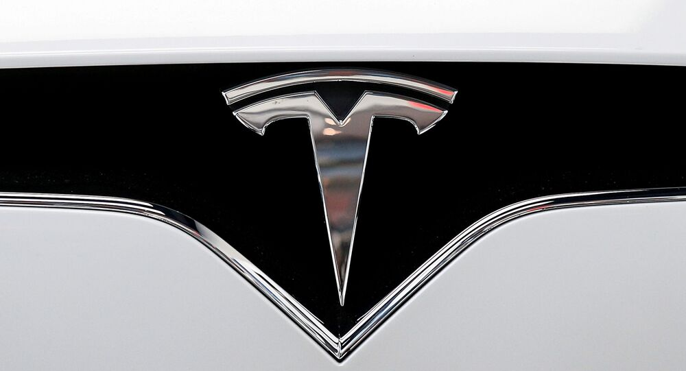 The Tesla logo is seen on a car at Tesla's new showroom in Manhattan's Meatpacking District in New York City, U.S., Dec. 14, 2017