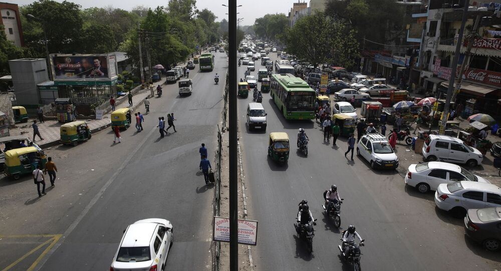 Few vehicles are seen plying on the otherwise severely busy Mehrauli Badarpur road during rush hour in New Delhi, India, Friday, April 15, 2016