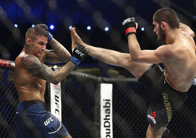 Russian UFC fighter Khabib Nurmagomedov, right, kicks UFC fighter Dustin Poirier, of Lafayette, La., during Lightweight title mixed martial arts bout at UFC 242, in Yas Mall in Abu Dhabi, United Arab Emirates, Saturday , Sept.7 2019