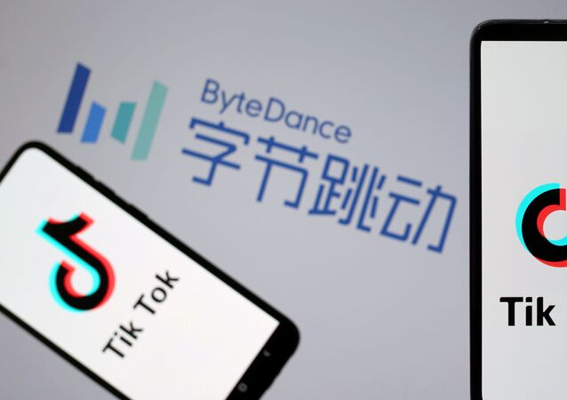 TikTok logos are seen on smartphones in front of a displayed ByteDance logo
