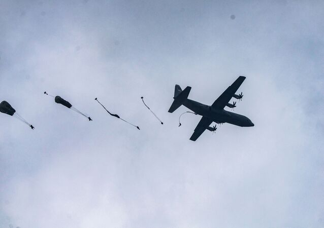 U.S. Army Paratroopers from the 1st Squadron (Airborne), 91st Cavalry Regiment, 173rd Airborne Brigade, jump from a C-130 Hercules during an airborne jump at Grafenwoehr Training Area, Germany, June 10, 2020