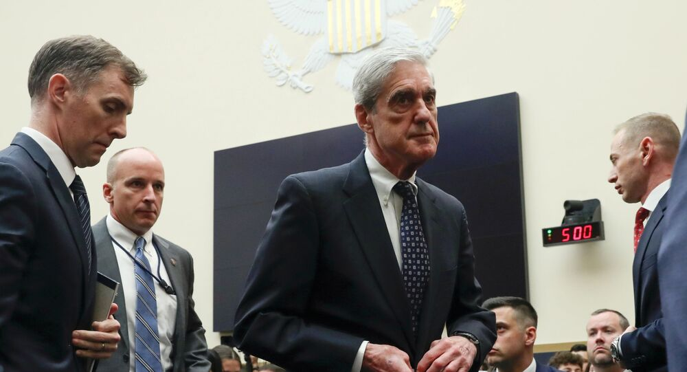 Former Special Counsel Robert Mueller walks during a break in testimony before a House Judiciary Committee hearing on the Office of Special Counsel's investigation into Russian Interference in the 2016 Presidential Election on Capitol Hill in Washington, U.S., July 24, 2019