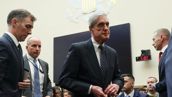 Former Special Counsel Robert Mueller walks during a break in testimony before a House Judiciary Committee hearing on the Office of Special Counsel's investigation into Russian Interference in the 2016 Presidential Election on Capitol Hill in Washington, U.S., July 24, 2019 - Sputnik International