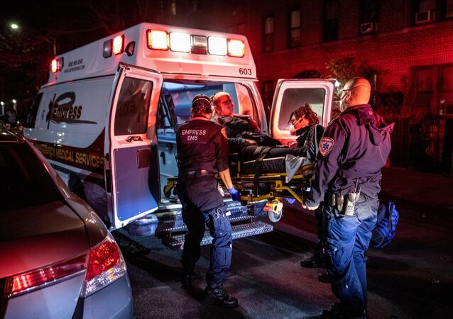 Medics load a patient into an ambulance in New York