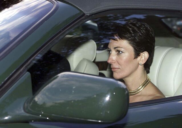 FILE - In this Sept. 2, 2000 file photo, British socialite Ghislaine Maxwell, driven by Britain's Prince Andrew leaves the wedding of a former girlfriend of the prince, Aurelia Cecil, at the Parish Church of St Michael in Compton Chamberlayne near Salisbury, England. The FBI said Thursday July 2, 2020, Ghislaine Maxwell, who was accused by many women of helping procure underage sex partners for Jeffrey Epstein, has been arrested in New Hampshire.