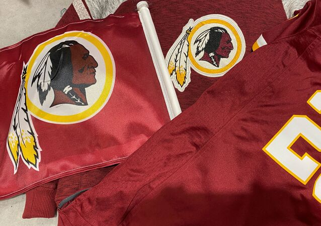 Washington Redskins football shirts and a team flag on sale at a sporting goods store in Bailey's Crossroads, Virginia, U.S., June 24, 2020