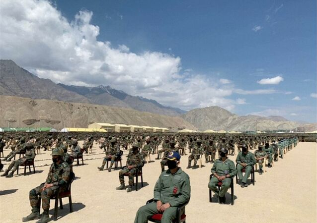 Soldiers await a visit by India's Prime Minister Narendra Modi in the Indian Himalayan desert region of Ladakh, 3 July 2020, in this still image taken from a video.