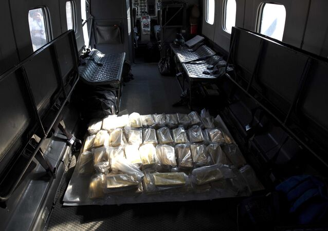 Gold bars sit inside a military plane before being taken to Venezuela's Central Bank, at Carlota military airport in Caracas, Venezuela, Thursday, March 1, 2018