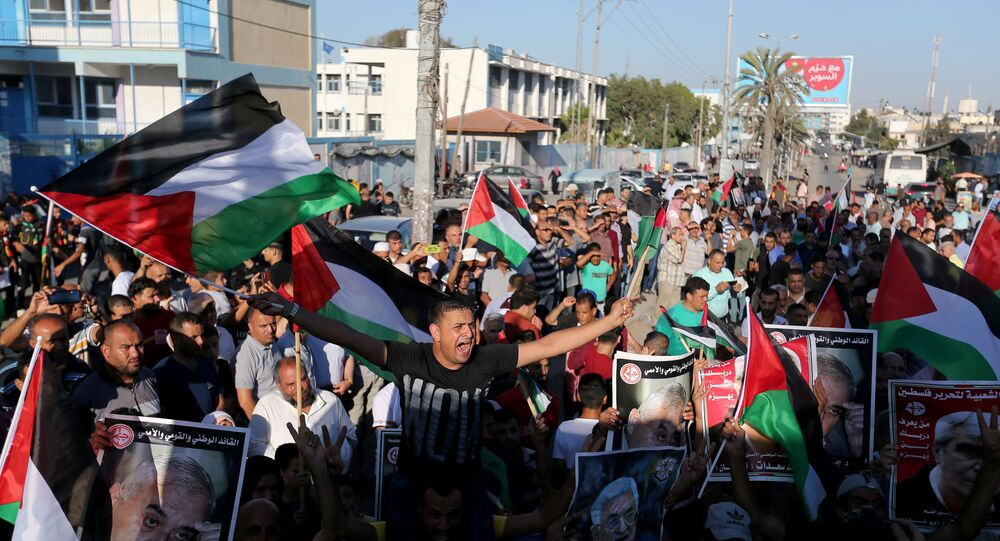 Palestinians take part in a protest against Israel's plan to annex parts of the Israeli-occupied West Bank, in Khan Younis in the southern Gaza Strip July 2, 2020.