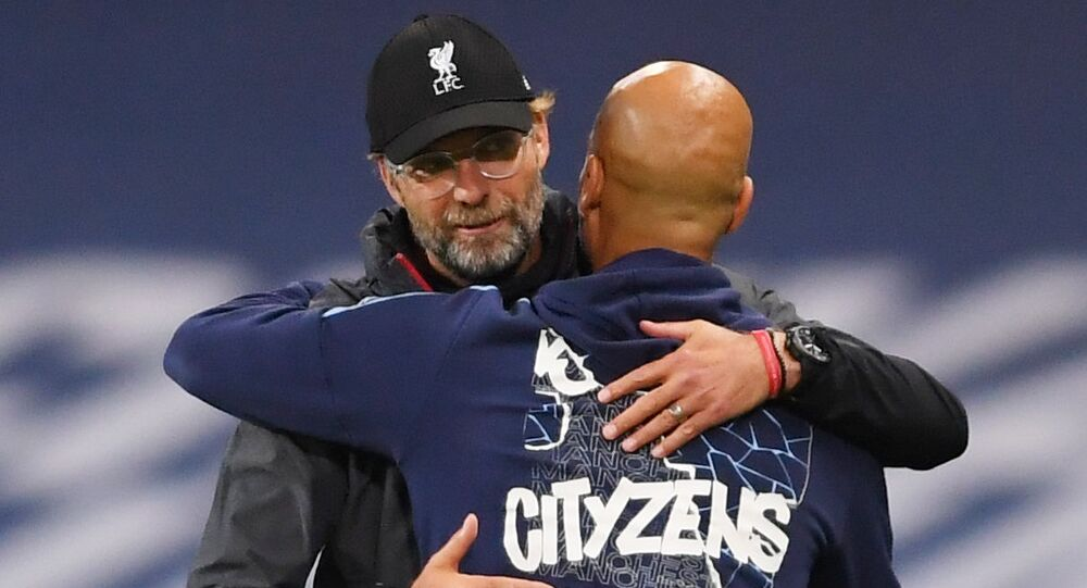 Liverpool manager Juergen Klopp with Manchester City manager Pep Guardiola after the match, as play resumes behind closed doors following the outbreak of the coronavirus disease (COVID-19).