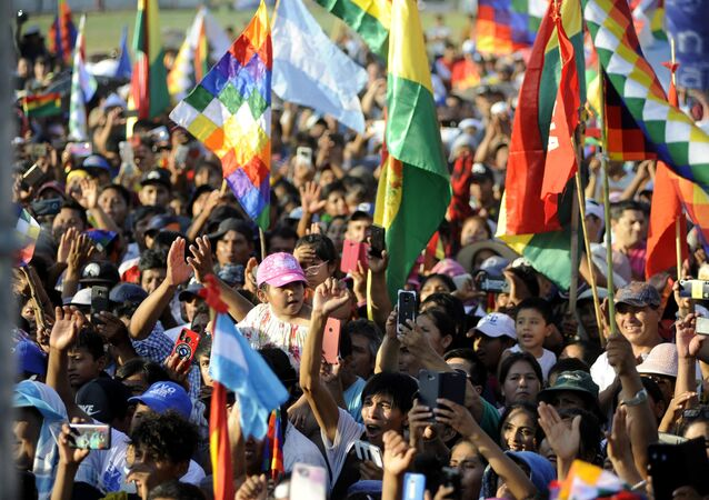 Supporters of former Bolivian President Evo Morales, exiled in Argentina, take part in a meeting organized by the Bolivianos Unidos group in Mendoza, to support the presidential candidate of the Movement to Socialism (MAS) party, Luis Arce, in Mendoza, Argentina, on March 07, 2020
