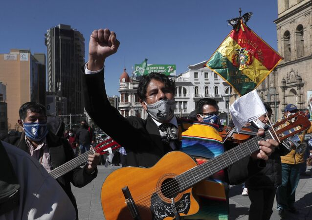 Musicians wearing face masks amid the new coronavirus pandemic march to protest against the government, in La Paz, Bolivia, Monday, June 8, 2020