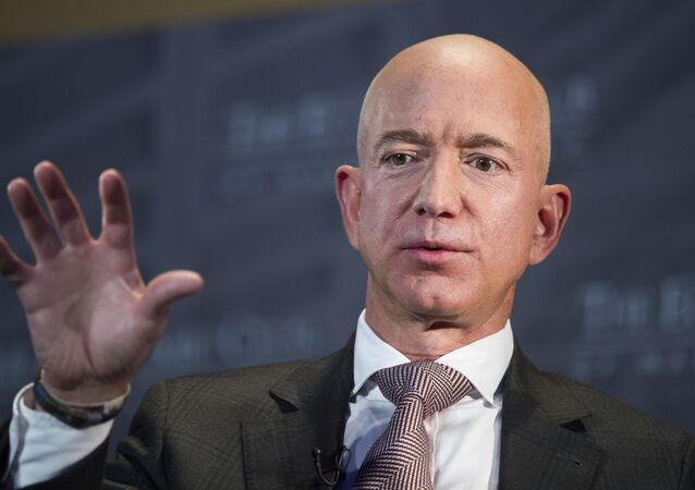 FILE- In this Sept. 13, 2018, file photo Jeff Bezos, Amazon founder and CEO, speaks at The Economic Club of Washington's Milestone Celebration in Washington. Bezos says the National Enquirer is threatening to publish nude photographs of him unless his private investigators back off the tabloid that detailed the billionaire's extramarital affair