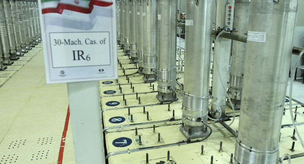 This photo released on Tuesday, Nov. 5, 2019, by the Atomic Energy Organization of Iran shows centrifuge machines in Natanz uranium enrichment facility in central Iran. Iran announced on Monday that had started gas injection into a 30-machine cascade of advanced IR-6 centrifuges in Natanz complex