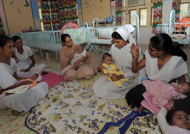 Orphaned Indian baby girls are cared for by nuns and staff at The Matruchhaya Orphanage which is run by The Sisters of Charity of St. Anne Trust in Nadiad some 60kms. from Ahmedabad on October 29, 2011