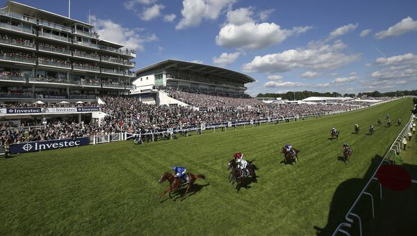 Masar ridden by jockey William Buick coming home to win the Investec Derby during derby day of the 2018 Investec Derby Festival at Epsom Downs Racecourse, Britain - Sputnik International