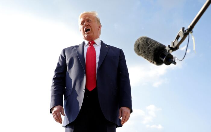 U.S. President Donald Trump speaks to reporters before boarding Air Force One for travel to U.S. Independence Day fireworks celebrations at Mount Rushmore in South Dakota from Andrews Air Force Base in Maryland, U.S. July 3, 2020.  REUTERS/Tom Brenner