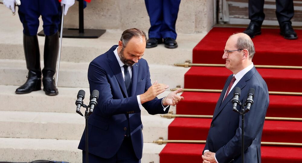 Former French Prime Minister Edouard Philippe applauds newly-appointed Prime Minister Jean Castex in the courtyard of the Matignon Hotel during the handover ceremony in Paris, France July 3, 2020.