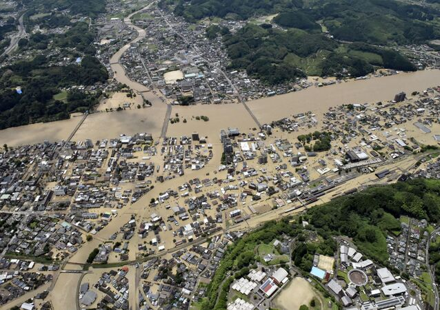 An aerial view shows flooded Kuma River caused by heavy rain at a residential area in Hitoyoshi, Kumamoto prefecture, southern Japan, in this photo taken by Kyodo 4 July  2020.