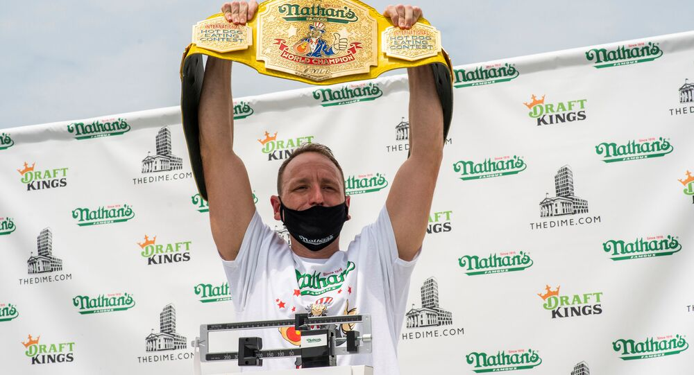 Current world record holder Joey Chestnut carries his belt as he poses during the official weigh-in ceremony for the Nathan's Famous Fourth of July International Hot Dog Eating Contest, in New York, U.S., July 3, 2020.