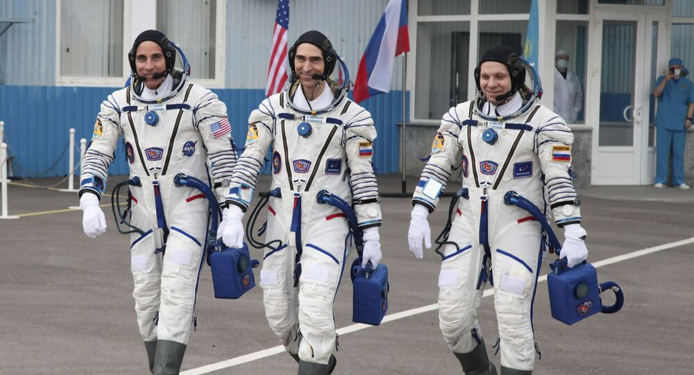 In this handout photo released by Roscosmos Space Agency Press Service U.S. astronaut Chris Cassidy, left, Russian cosmonauts Anatoly Ivanishin, centre, and Ivan Vagner, members of the main crew of the expedition to the International Space Station (ISS), walk prior the launch of Soyuz MS-16 space ship at the Russian leased Baikonur cosmodrome, Kazakhstan, Thursday, April 9, 2020.