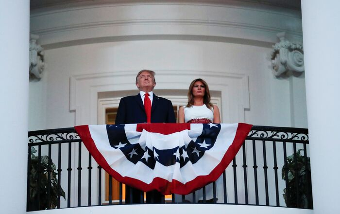 U.S. President Donald Trump and first lady Melania Trump watch the Washington, D.C. fireworks display from the Truman Balcony as they celebrate the U.S. Independence Day holiday at the White House in Washington, U.S., July 4, 2020.
