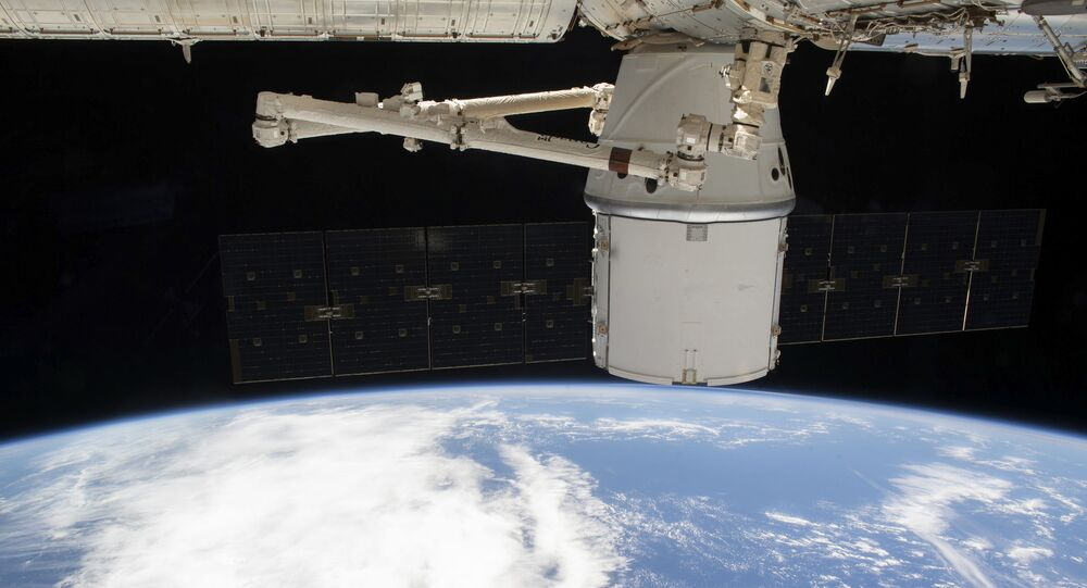 This NASA photo obtained March 10, 2020 shows the SpaceX Dragon resupply ship attached to the International Space Station's (ISS) Harmony module as both spacecraft were soaring 265 miles above the Atlantic coast of Brazil on March 9, 2020.
